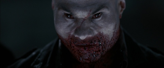 A picture of the bald vampire from 30 Days of Night and his face is covered in blood.